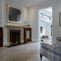 Blue and white checked chair, limestone flooring and parquet flooring.
