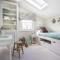 Girls bedroom with blue and purple accents, hand blocked blind, white desk and wooden stool.
