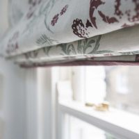 Hand blocked purple and turquoise roman blind.