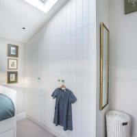 Bespoke tongue and groove wardrobe in girls bedroom.