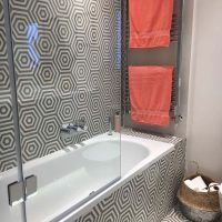 Grey and white hexagonal bathroom tiles with Coral Towels