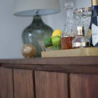 Graham and Green sideboard with gold drinks tray and Heathfield lamp