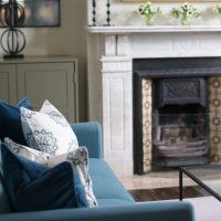 Blue wool sofa with blue velvet cushion and blue hand blocked cushion