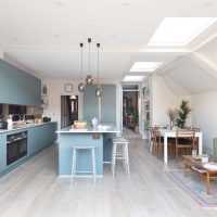 Blue handleless kitchen Ealing with grey limed wood flooring