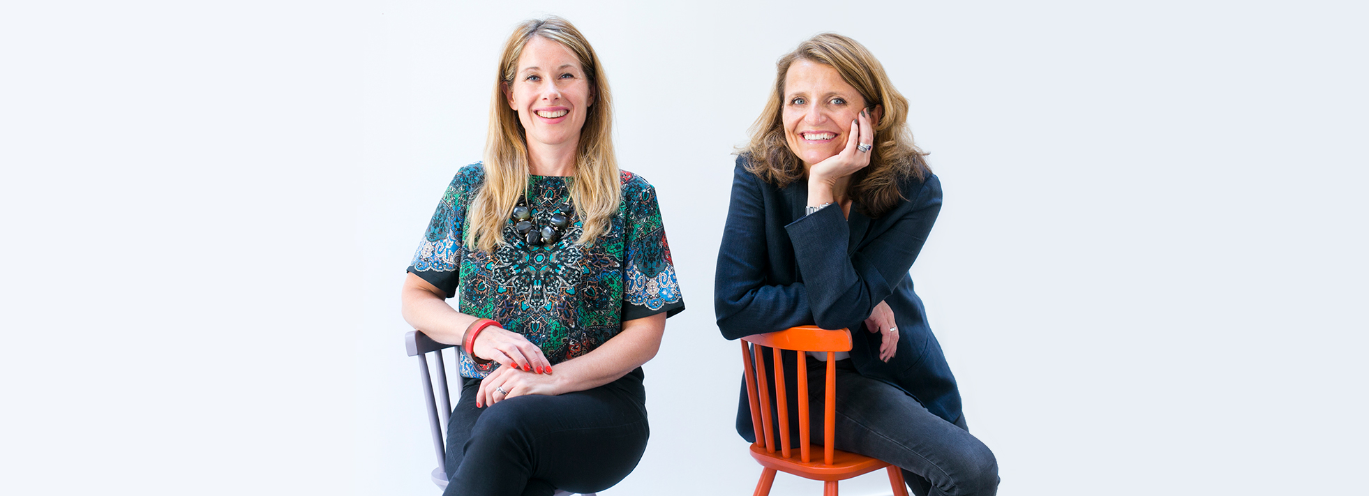 Ali Johnson and Alex Keith sitting on purple chair and orange chair