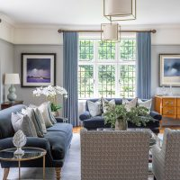 Formal drawing room in greys and blue with bespoke upholstery and cushions.