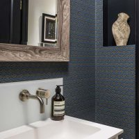Cloakroom with blue and black Neisha Crosland wallpaper.