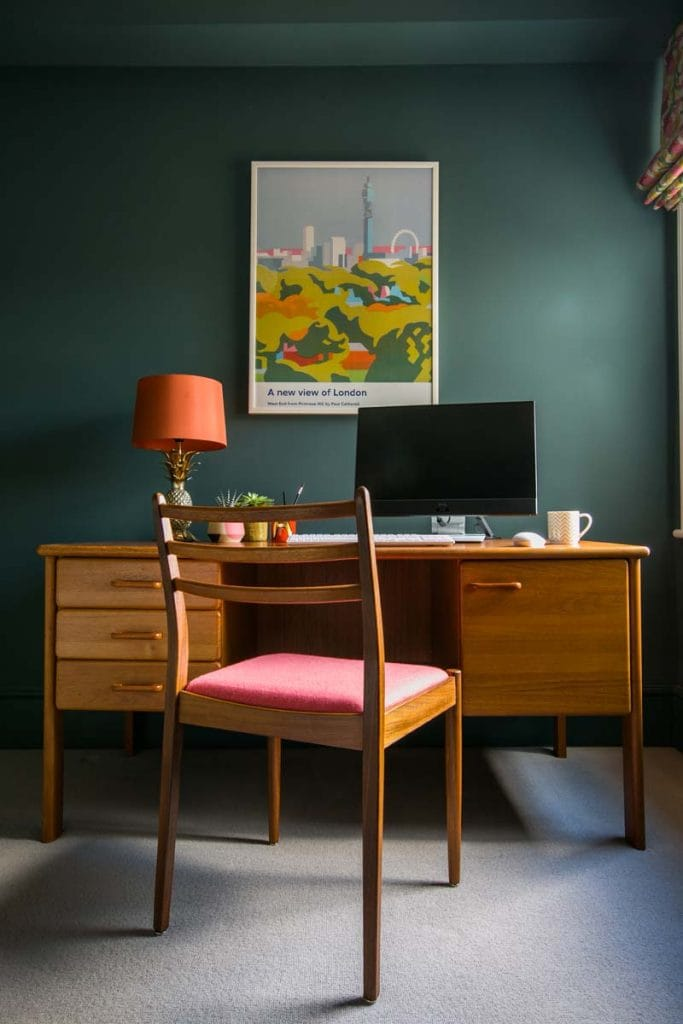 Farrow & Ball Inchyra Blue Study in Ealing with Danish mid century desk with coral lamp and G Plan chair.
