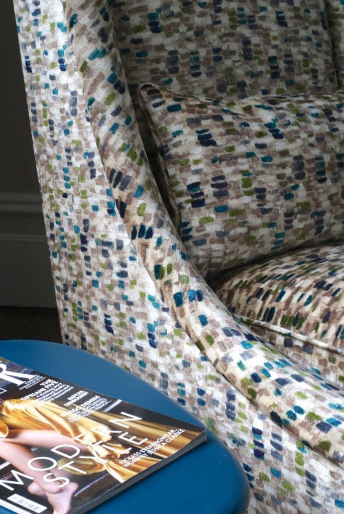 Ochre armchair covered in Romo fabric