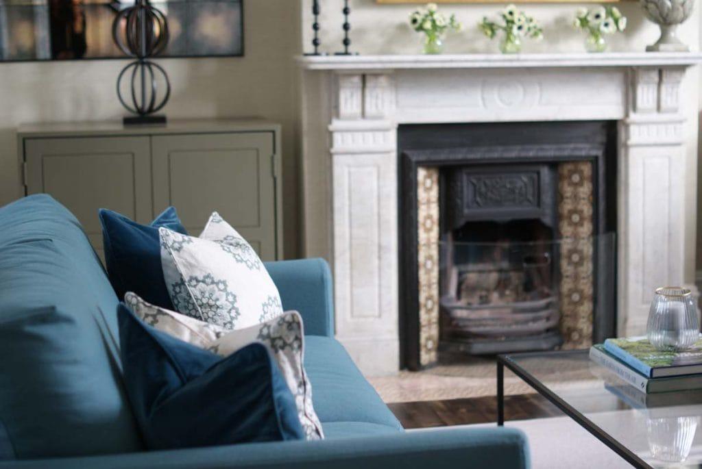 Blue wool sofa with blue velvet cushion and blue hand blocked cushion