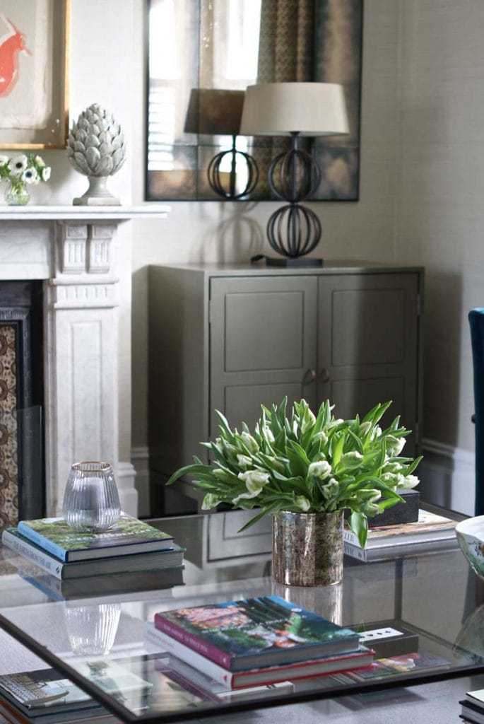 Chelsea textiles cabinet with marble fireplace and Heathfield light.