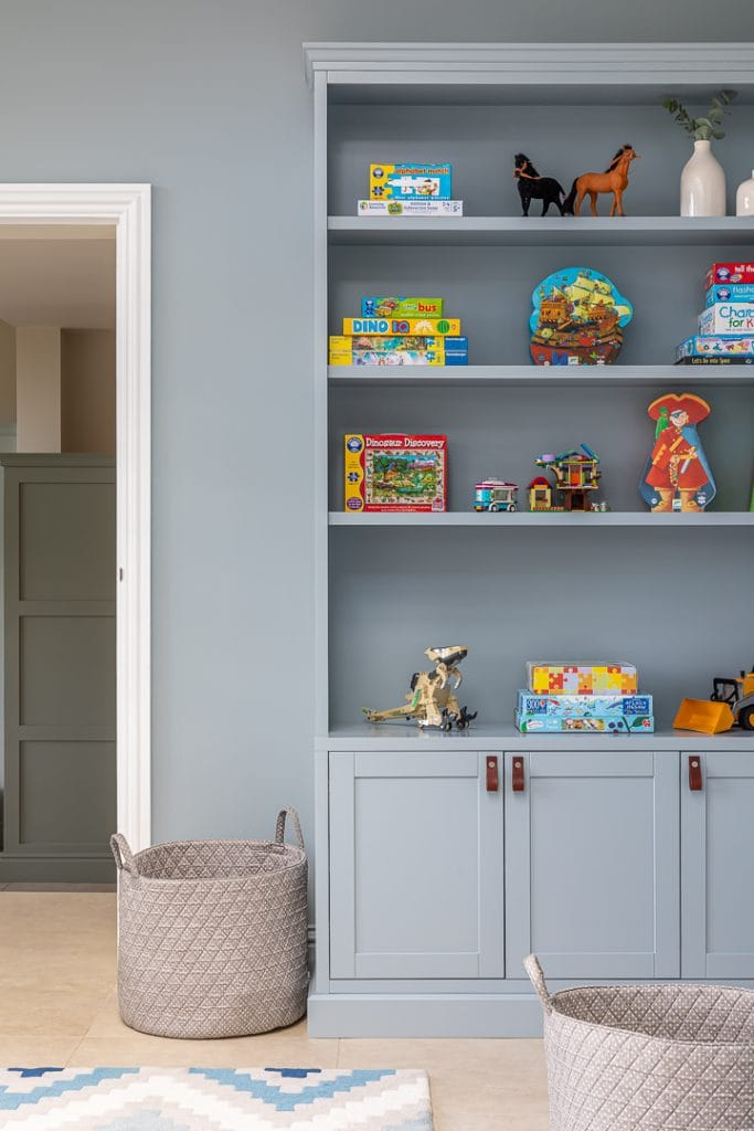 China Blue bespoke toy storage with brown leather pull.