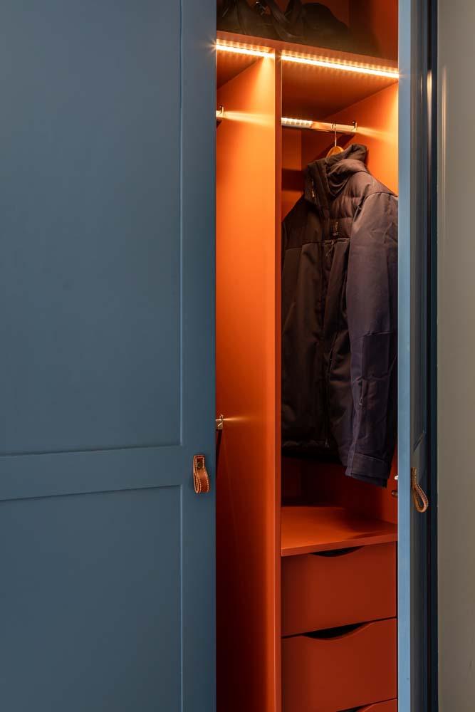 Inside of bespoke joinery painted in orange.