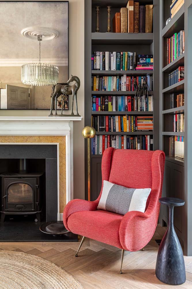 Bespoke library joinery, Looking Glass of Bath mirror, Fiona McDonald red mid century armchair, Vaughan brass floor light and Julian Chichester side table.